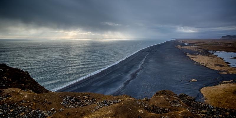 Lighthouse at Dyrhólaey Arch, Iceland 9